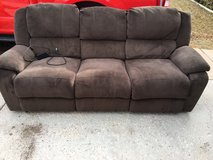 Brown microfiber couch with power recliners in Fort Carson, Colorado