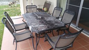 Patio set with 6 chairs and umbrella in Okinawa, Japan