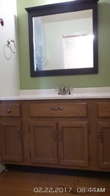 OAK BATHROOM VANITY CABINET WITH OFF-WHITE TOP & NICKEL FAUCET in Naperville, Illinois