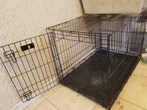Large wire dog kennel in Yucca Valley, California