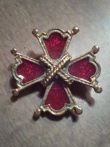 Red & gold cross brooch in Coldspring, Texas