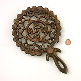 LG BRONZE TULIP IN MOTION TRIVET / POT HOLDER, footed in St. Charles, Illinois