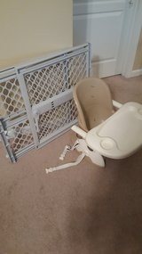 Baby gate and portable high chair in Fort Rucker, Alabama