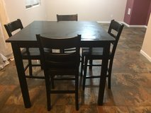 Black kitchen table with four chairs in Colorado Springs, Colorado