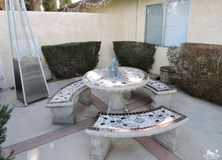 LARGE TILED CONCRETE CEMENT PATIO TABLE AND BENCHES in Yucca Valley, California