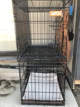 "Set of two black metal dog kennels 18"" tall by 20"" long in Fort Carson, Colorado"