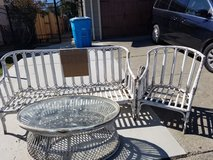 Wicker couch, chair  and glass table in Fairfield, California