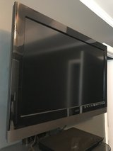 "32"" Vizio Television with wall mount and glass wall shelf in Camp Lejeune, North Carolina"