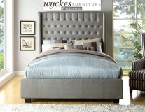 Grey high headboard tufted fabric bed in Los Angeles, California