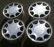 "Nissan 15x6jj alloy wheels with center caps, 5x4.5"" bolt pattern, 35 mm offset in Fort Lewis, Washington"