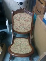 Antique folding rocking chair with tapestry seat in Tampa, Florida