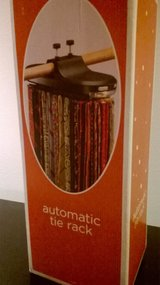 Automatic  Tie rack- never used, still in box in Columbus, Ohio