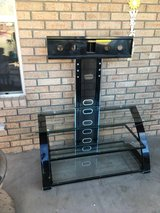 Glass tv stand with swivel mount in Alamogordo, New Mexico