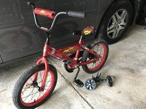 """Lightning McQueen 16"""" bike with training wheels AND helmet in Glendale Heights, Illinois"""