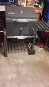 "Kingsford 24"" charcoal bbq grill with adjustable charcoal tray (moving need gone asap) in Travis AFB, California"