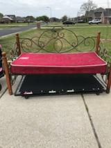 Twin trundle bed with pop up frame. Solid wood posts with ornate metal sides and back. One mattr... in Baytown, Texas