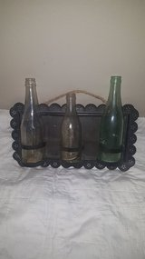 Bottles with tin holder in Baytown, Texas