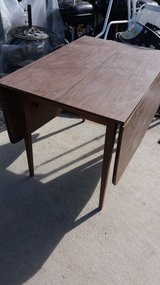 Drop sided table and 4 chairs in Fort Riley, Kansas