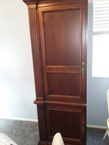 Walnut left side entertainment cabinet in Lake Elsinore, California