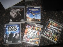 Assorted PS3 games and controllers in Yucca Valley, California