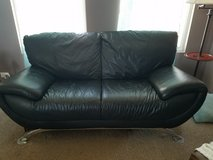 Black leather couch in Bolingbrook, Illinois