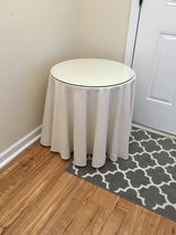 Round glass top end table in Camp Lejeune, North Carolina