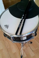 Snare drum with sticks and silencer/practice pad in Naperville, Illinois