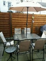 16 Pc. Patio Set w/ new cushions and tablecloth (tan) in Ramstein, Germany