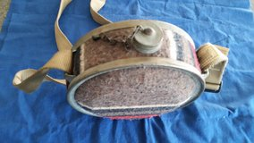 Old style metal canteen with blanket covered sides w/ rifle sling strap in Camp Lejeune, North Carolina
