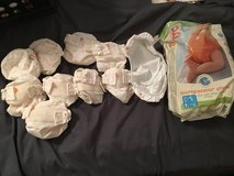 9 newborn g diaper covers and 16 inserts. in Vacaville, California
