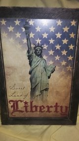 Wooden framed wall art of the Statue of Liberty in Fort Campbell, Kentucky
