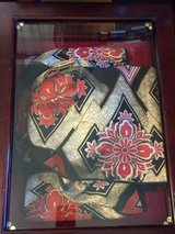 Japanese Obi Decor in a Glass Case in Cherry Point, North Carolina