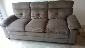 Small brown couch with matching chair in Sacramento, California