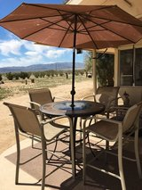 Outdoor Patio Table with 4 Chairs and Umbrella in 29 Palms, California