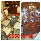Kitchen table with chairs and China hutch in Pensacola, Florida