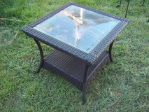 Glass top outdoor end table in Alamogordo, New Mexico