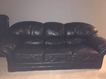 Black leather couch in Naperville, Illinois