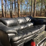 beautiful black leather couch and oversized chair used but in good shape in Camp Lejeune, North Carolina