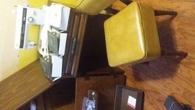 Sewing Machine in Cabinet & Old Sewing Chair + lots of accessories in Baytown, Texas