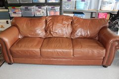 Rustic Brown leather sofa with Nailhead trim in Oceanside, California