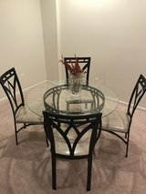 Glass table for party of 4. Butlers pantry with wine rack in Fairfax, Virginia