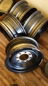 (4) 8 lug 8x6.5 Bolt pattern GM steel Rims with Caps and lug nuts in Camp Lejeune, North Carolina