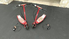 Razor E100 Electric Scooter (2 available) $75 each NEW BATTERIES in Plainfield, Illinois
