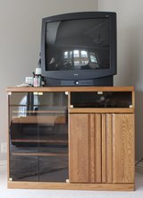 TV Stand wood and glass front in Bartlett, Illinois