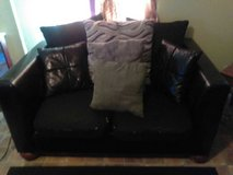 Leather sofa and love seat with pillows in Dothan, Alabama
