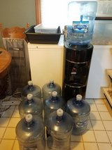Oasis Black Hot/Cold Water Cooler Dispenser w/ Eight (8) Water Bottles in Lockport, Illinois