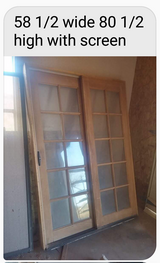 sliding glass panel door with screen in Alamogordo, New Mexico