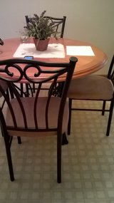 wrought iron/wood table and 4 chairs in Joliet, Illinois