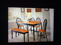 Dining table with two chairs and a bench. in Fort Sam Houston, Texas