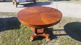 round wooden dining table in Wilmington, North Carolina